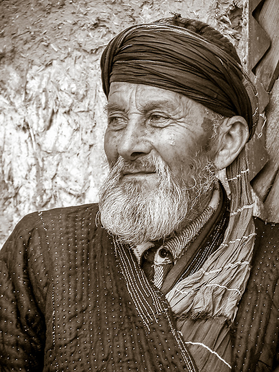 Portrait of an old Tajik man contemplating the scene (a wedding) with a sense of satisfaction and approval
