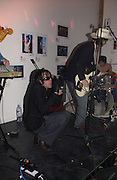 John Paul Prior singing with the Lancaster Bombers. Babyshambles Exhibition , Photographs by Danny Clifford <br />The Old Sony Ericsson Proud Galleries, Greenland St. Camden, London  5 December  2005. ONE TIME USE ONLY - DO NOT ARCHIVE  © Copyright Photograph by Dafydd Jones 66 Stockwell Park Rd. London SW9 0DA Tel 020 7733 0108 www.dafjones.com