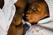 Rosina Adom breast feeds her daughter during a meeting for members of a breast feeding support group at the La Polyclinic in Accra, Ghana on Tuesday June 16, 2009.
