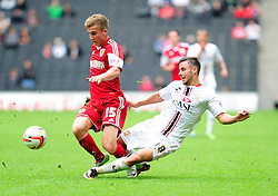 Milton Keynes Dons' George Baldock fouls Bristol City's Joe Bryan  - Photo mandatory by-line: Dougie Allward/JMP - Tel: Mobile: 07966 386802 24/08/2013 - SPORT - FOOTBALL - Stadium MK - Milton Keynes -  Milton Keynes Dons V Bristol City - Sky Bet League One