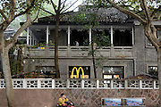 HANGZHOU, CHINA - NOVEMBER 15: (CHINA OUT) <br /> <br /> Chiang Ching-kuos Former Residence Turns Into A McDonalds<br /> <br /> A woman makes a phone call outside Chiang Ching-kuos villa near West Lake on November 15, 2015 in Hangzhou, Zhejiang Province of China. Former Taiwan leader Chiang Ching-kuo, son of former Kuomintang leader Chiang Kai-shek, lived with his family in this two-story villa built in 1931 from the end of the War of Resistance against Japanese Aggression (1937-45) until they left for Taiwan in 1949. Two months earlier a Starbucks outlet opened in the side wing of the same house, the report said and now it still open a McDonald's in this historical villa. Controversy goes about in public that the old residence turning into a commercial place would go against the preservation of the historical site<br /> ©Exclusivepix Media