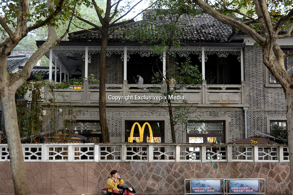 HANGZHOU, CHINA - NOVEMBER 15: (CHINA OUT) <br /> <br /> Chiang Ching-kuos Former Residence Turns Into A McDonalds<br /> <br /> A woman makes a phone call outside Chiang Ching-kuos villa near West Lake on November 15, 2015 in Hangzhou, Zhejiang Province of China. Former Taiwan leader Chiang Ching-kuo, son of former Kuomintang leader Chiang Kai-shek, lived with his family in this two-story villa built in 1931 from the end of the War of Resistance against Japanese Aggression (1937-45) until they left for Taiwan in 1949. Two months earlier a Starbucks outlet opened in the side wing of the same house, the report said and now it still open a McDonald's in this historical villa. Controversy goes about in public that the old residence turning into a commercial place would go against the preservation of the historical site<br /> &copy;Exclusivepix Media
