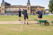 Wicket repairs before Day 3 of the Specsavers County Champ Div 2 match between Gloucestershire County Cricket Club and Leicestershire County Cricket Club at the Cheltenham College Ground, Cheltenham, United Kingdom on 17 July 2019.