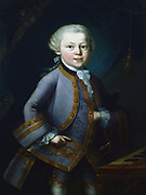 Wolfgang Amadeus Mozart (1756-1791) Austrian composer. Mozart aged 7, in gala dress, standing by keyboard. Anonymous. Mozarteum, Salzburg.