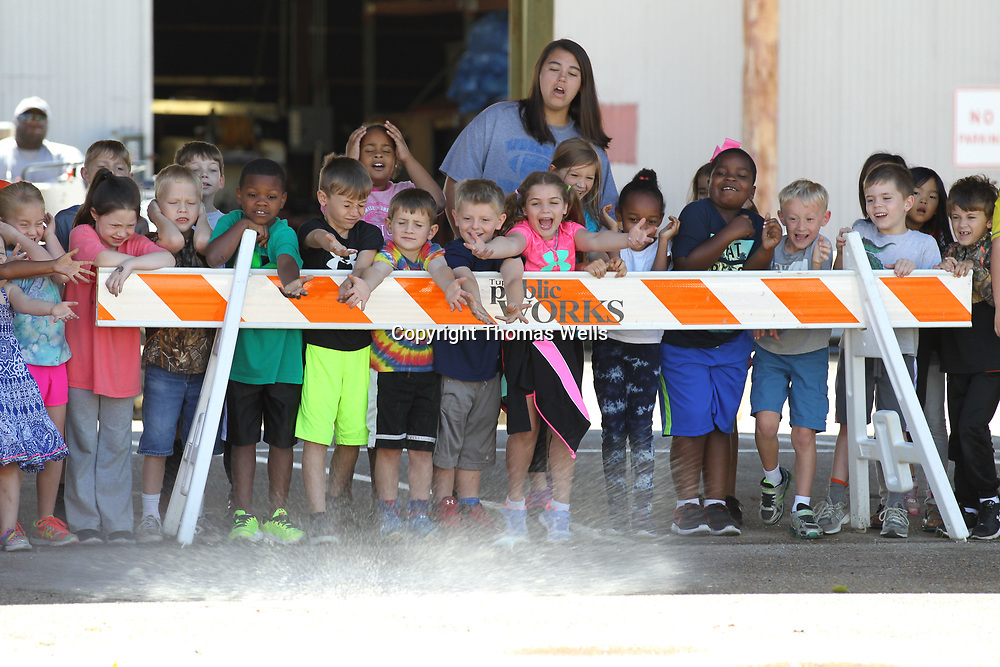 Students from CASA react as water balloons impact the ground as they visit the Tupelo Public Works Facility on Thursday.