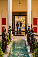 Five statues of young women (peplophoroi). Modern replicas of ancient bronze sculptures found in the Villa dei Papiri at Herculaneum, Italy (which are now in the Museo Archeologico Nazionale in Naples, Italy). Getty Villa, Pacific Palisades (near Malibu), California USA.