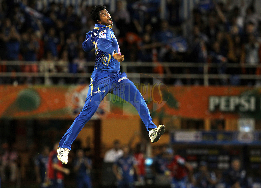 Pragyan Ohja of the Mumbai Indians celebrates the wicket of Brendon McCullum of The Chennai Superkings during the eliminator match of the Pepsi Indian Premier League Season 2014 between the Chennai Superkings and the Mumbai Indians held at the Brabourne Stadium, Mumbai, India on the 28th May  2014<br /> <br /> Photo by Vipin Pawar / IPL / SPORTZPICS<br /> <br /> <br /> <br /> Image use subject to terms and conditions which can be found here:  http://sportzpics.photoshelter.com/gallery/Pepsi-IPL-Image-terms-and-conditions/G00004VW1IVJ.gB0/C0000TScjhBM6ikg