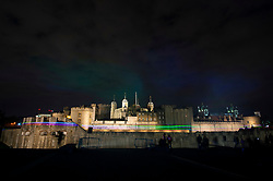 © Licensed to London News Pictures. 04/04/2019. London, UK. Artist Dan Acher recreates The Northern Lights over the Tower of London. The installation marked the launch of the new Huawei P30 series camera. London, UK. Photo credit: Ray Tang/LNP