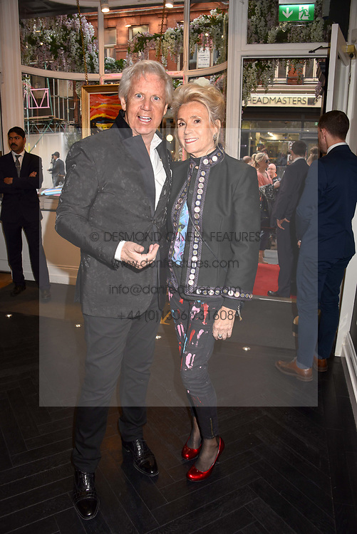 James Nicholls and Danielle Nicholls at a private view of work by Bradley Theodore entitled 'The Second Coming' at the Maddox Gallery, 9 Maddox Street, London England. 19 April 2017.