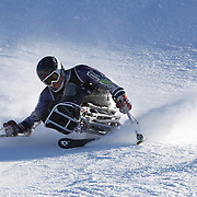 Stephen Lawler, USA, in action during the Men's Slalom Sitting, Adaptive Slalom competition at Coronet Peak, New Zealand during the Winter Games. Queenstown, New Zealand, 25th August 2011. Photo Tim Clayton