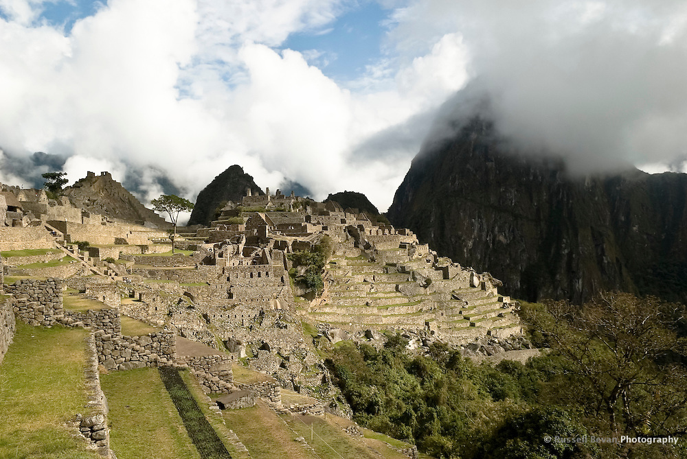The Eastern Side of Machu Picchu and the agricultural terraces with Huayna Picchu Engulfed in Cloud in the Peruvian Andes