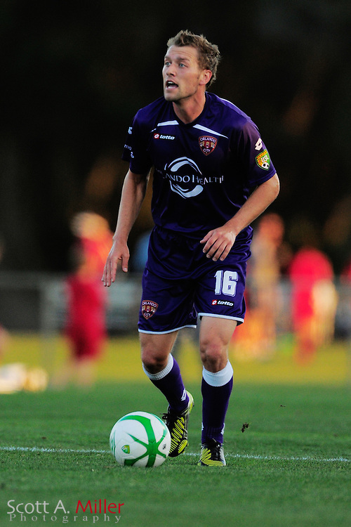Orlando City Lions midfielder Freddie Braun (16) brings the ball upfield during the Lions game against the Stetson Hatters at the Seminole Soccer Complex on Mar 13, 2013  in Sanford, Florida. ..©2013 Scott A. Miller