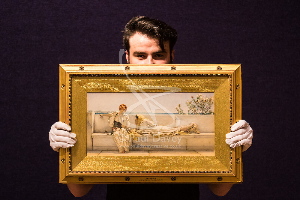 Bonhams, London, February 22nd 2017. Bonhams in London hold a press preview ahead of their 19th century paintings sale, featuring numerous valuable works including:<br /> • 'Children by the shore' by Dorothea Sharp, valued at £60,000-80,000<br /> • Barcas y pescaadores, Playa de Valencia by Joaquin Sorolla £60,000-80,000<br /> • When the Boats Come In by Walter Osborne valued at £100,000-150,000<br /> • A Solicitation by Lawrence Alma-Tadema which is expected to fetch between £30,000-50,000<br /> PICTURED: A gallery porter displays A Solicitation by Lawrence Alma-Tadema
