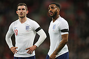 England defender Danny Rose (12) and England midfielder Lewis Cook (19) look at the VAR decision on the big screen during the Friendly match between England and Italy at Wembley Stadium, London, England on 27 March 2018. Picture by Toyin Oshodi.