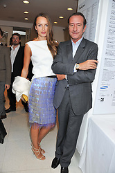 ROBERT HANSON and his wife MASHA MARKOVA at a private view of Yoko Ono's work - To The Light held at The Serpentine Gallery, Kensington Gardens, London on 19th June 2012.