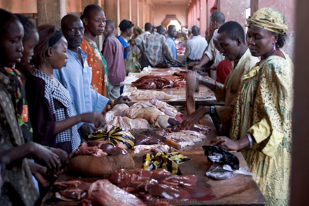 Tables of beef viscera for sale in a market in N'Djamena, the capital of Chad. Although meat in the United States and Europe mainly comes from factory farms and is sold in shrink-wrapped packages, most animal products elsewhere (as these photographs demonstrate)come from small-scale producers and are sold by butchers.