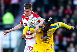 Michy Batshuayi of Crystal Palace challenges Paul Downing of Doncaster Rovers - Mandatory by-line: Robbie Stephenson/JMP - 17/02/2019 - FOOTBALL - The Keepmoat Stadium - Doncaster, England - Doncaster Rovers v Crystal Palace - Emirates FA Cup fifth round proper