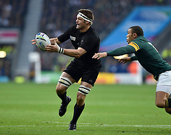 Richie McCaw of New Zealand passes the ball - Mandatory byline: Patrick Khachfe/JMP - 07966 386802 - 24/10/2015 - RUGBY UNION - Twickenham Stadium - London, England - South Africa v New Zealand - Rugby World Cup 2015 Semi Final.