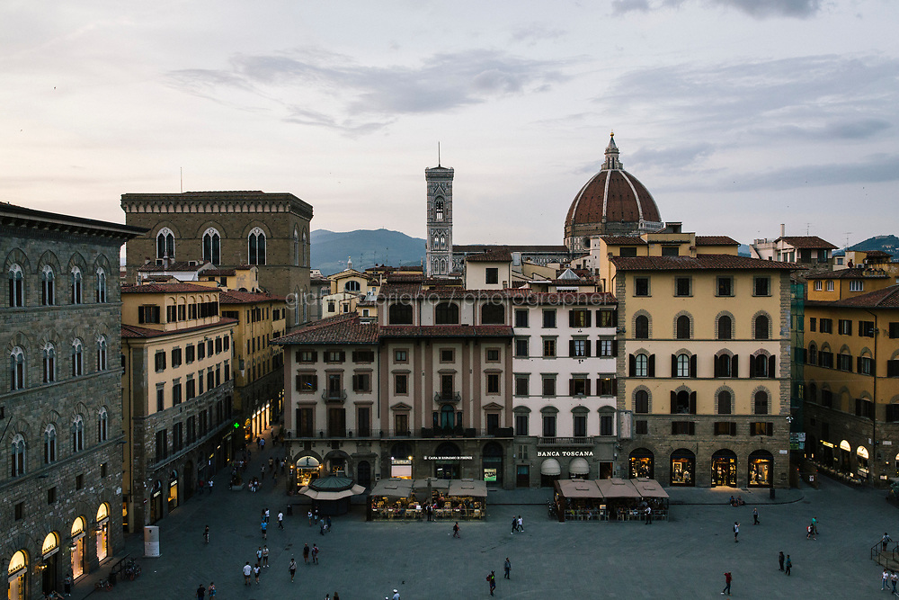FLORENCE, ITALY - 3 JUNE 2018: A view of the historical center of Florence is seen here from the terrace of the Uffizi, in Florence, Italy, on June 3rd 2018.<br /> <br /> As of Monday June 4th 2018, Room 41 or the &ldquo;Raphael and Michelangelo room&rdquo; of the Uffizi is part of the rearrangement of the museum's collection that has<br /> been defining Uffizi Director Eike Schmidt&rsquo;s grander vision for the Florentine museum.<br /> Next month, the museum&rsquo;s Leonardo three paintings will be installed in a<br /> nearby room. Together, these artists capture &ldquo;a magic moment in the<br /> first decade of the 16th century when Florence was the cultural and<br /> artistic center of the world,&rdquo; Mr. Schmidt said. Room 41 hosts, among other paintings, the dual portraits of Agnolo Doni and his wife Maddalena Strozzi painted by Raphael round 1504-1505, and the &ldquo;Holy Family&rdquo;, that Michelangelo painted for the Doni couple a year later, known as the<br /> Doni Tondo.