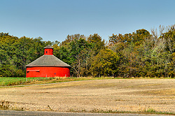 08 September 2006  a sizeable round barn with a round cupola with sliding doors stands in a meadow in the fall in Parke County Indiana.<br /> <br /> This image was produced in part utilizing High Dynamic Range (HDR) processes.  It should not be used editorially without being listed as an illustration or with a disclaimer.  It may or may not be an accurate representation of the scene as originally photographed and the finished image is the creation of the photographer.