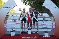 Winners receive their medals after completing The Surrey 100 during The Prudential RideLondon weekend.<br /> Sunday 2nd August 2015. <br /> 1st Jean Pierre Drucker<br /> 2nd Mike Teunissen Mike<br /> 3rd Ben Swift<br /> <br /> <br /> Prudential RideLondon is the world's greatest festival of cycling, involving 95,000+ cyclists – from Olympic champions to a free family fun ride - riding in five events over closed roads in London and Surrey over the weekend of 1st and 2nd August 2015. <br /> <br /> Photo: Paul Gregory<br /> <br /> See www.PrudentialRideLondon.co.uk for more.<br /> <br /> For further information: Penny Dain 07799 170433<br /> pennyd@ridelondon.co.uk