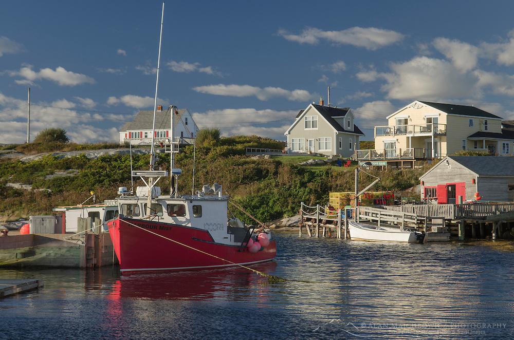 Red fishing boat and fisherman's shacks at Peggy's Cove Nova Scotia