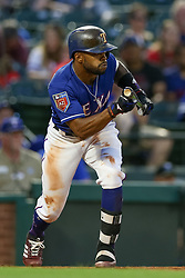 March 26, 2018 - Arlington, TX, U.S. - ARLINGTON, TX - MARCH 26: Texas Rangers center fielder Delino DeShields (3) squares to bunt during the exhibition game between the Cincinnati Reds and Texas Rangers on March 26, 2018 at Globe Life Park in Arlington, TX. (Photo by Andrew Dieb/Icon Sportswire) (Credit Image: © Andrew Dieb/Icon SMI via ZUMA Press)