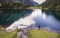 THEMENBILD - ein Mann am Ufer am Hintersee, aufgenommen am 23. Juni 2019 in Mittersill, Österreich // a man on the shore at Hintersee, Mittersill, Austria on 2019/06/23. EXPA Pictures © 2019, PhotoCredit: EXPA/ JFK