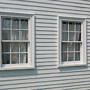 Windows in the Rev. Daniel Putnam House built in 1720 stands in North Reading, Massachusetts.