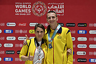 Abu Dhabi, United Arab Emirates - 2019 March 15: (2L) Andrei Ovcharenko from Kazachstan with his trophy in bocce with his coach while awarding ceremony Special Olympics World Games Abu Dhabi 2019 on March 15, 2019 in Abu Dhabi, United Arab Emirates. (Mandatory Credit: Photo by (c) Adam Nurkiewicz)