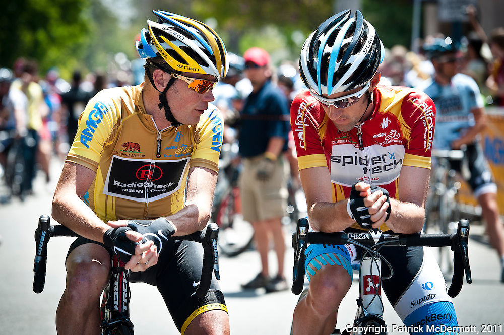 From left, Radioshack rider Levi Leipheimer of the United States and Spidertech rider Patrick McCarty of the United States speak at the start line during stage seven of the 2011 AMGEN Tour of California from Claremont to Mt. Baldy in Claremont, Calif. on Saturday, May 21, 2011.