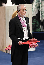 "Nobelpreisverleihung 2016 in der Konzerthalle in Stockholm / 101216 ***Japanese scientist Yoshinori Ohsumi receives the Nobel Prize in physiology or medicine for his research on cell recycling, at an award ceremony in Stockholm on Dec. 10, 2016. Ohsumi elucidated ""autophagy,"" an intracellular process that degrades and recycles proteins."