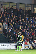 Bayo Akinfenwa of AFC Wimbledon in front of the travelling fans during the Sky Bet League 2 match between Newport County and AFC Wimbledon at Rodney Parade, Newport, Wales on 19 December 2015. Photo by Stuart Butcher.