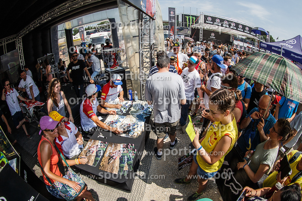 Tim Gajser of Slovenia #243 with Evgeny Bobryshev of Russia #777 and Gautler Paulin of France #21 signing autographs before MXGP race for MXGP Championship in Mantova, Italy on 26th of June, 2016 in Italy Photo by Grega Valancic / Sportida