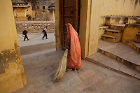 A woman sweeps the ground inside the walls a a Ganesh Temple near the amber fort just outside Jaipur City india Nov. 16, 2006 Jaipur India.    (photo by Darren Hauck)..................