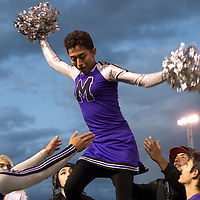 100114      Cayla Nimmo<br /> <br /> Miyamura senior Cameron Abeita attempts a lift during the traditional homecoming powder puff game at Public School Stadium Wednesday night.