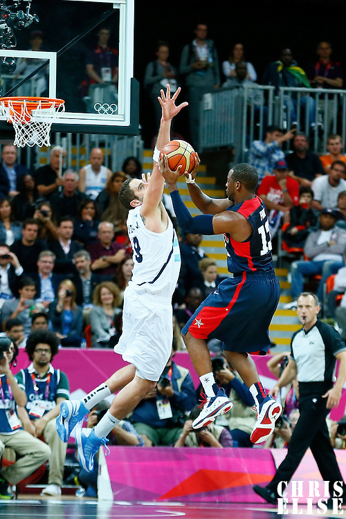 06 August 2012: Argentina Juan Pedro Gutierrez defends on USA Chris Paul during 126-97 Team USA victory over Team Argentina, during the men's basketball preliminary, at the Basketball Arena, in London, Great Britain.