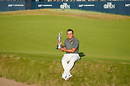Francesco Molinari on the 18th green with the claret jug after winning the Open Championship