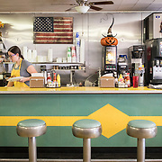 Hannah Cooper gathers food as a server in the Dixie Diner, in downtown Smithsburg, Maryland, on Tuesday, September 26, 2017. Smithsburg is a very different town than the southern part of the district that includes Potomac and Germantown. Originally a District that was mostly rural, but included towns like Frederick and Hagerstown, Maryland's 6th District was redistricted in 2011, combining rural northern Maryland regions with more affluent communities like near Washington D.C. turning the district from Republican to Democrat. <br />  <br /> CREDIT: John Boal for The Wall Street Journal<br /> GERRYMANDER