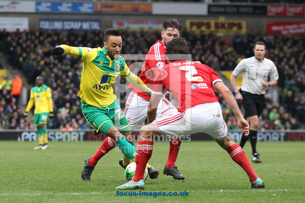 Nathan Redmond of Norwich takes on the Forest defence during the Sky Bet Championship match at Carrow Road, Norwich<br /> Picture by Paul Chesterton/Focus Images Ltd +44 7904 640267<br /> 21/03/2015