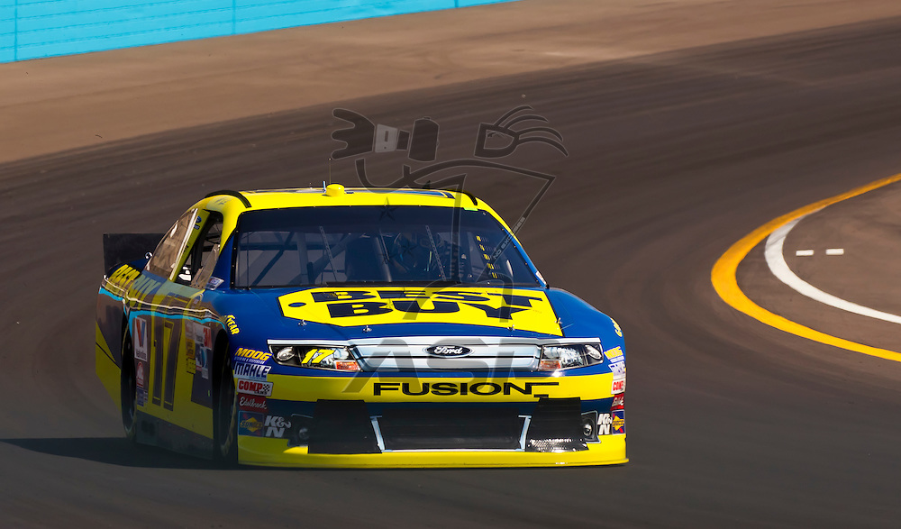 AVONDALE, AZ - MAR 03, 2012:  Matt Kenseth (17) brings his NASCAR Sprint Cup car through turn 4 during qualifying for the Subway Fresh Fit 500 race at the Phoenix International Raceway in Avondale, AZ.