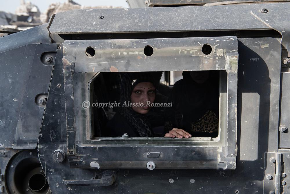 IRAQ, Mosul: A n Iraqi civilian woman is seen inside an Iraqi Special forces Humve in the Old city of Mosul. Alessio Romenzi