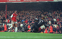 Thierry Henry chips the ball over Manchester City goalkeeper Nicky Weaver to score the 5th Arsenal goal. Arsenal v Manchester City, F.A.Carling Premiership, 28/10/2000. Credit Colorsport / Stuart MacFarlane.