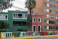 Lima, Peru -- April 13, 2018. A bright amd multicolored painted fence in front of residences in the upscale  Barranco District of Lima, Peru. Editorial use only.