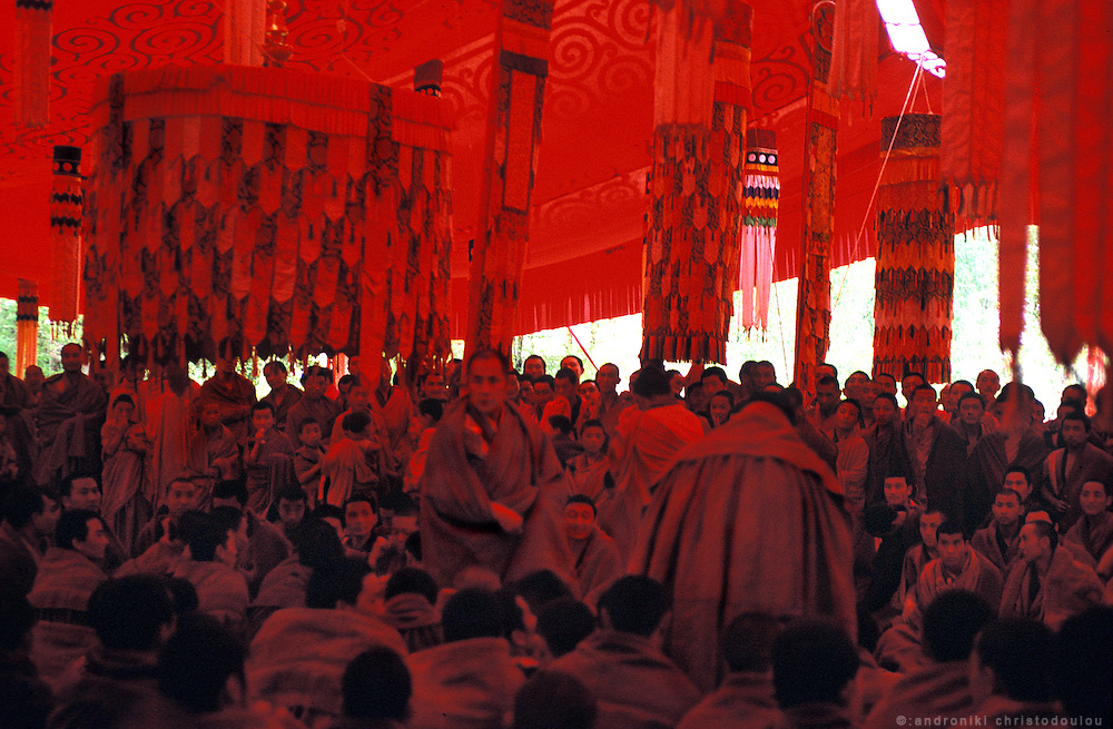 Everything becomes red under a red tent in the garden of the monastery. There, monks have loud philishophical debates every afternoon..LAMBRANG MONASTERY IN XIAHE - CHINA.copyright: Androniki Christodoulou
