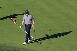 June 11, 2019 - Pebble Beach, CA, U.S. - PEBBLE BEACH, CA - JUNE 11: PGA golfer Ernie Els pulls the flag on the 7th hole during a practice round for the 2019 US Open on June 11, 2019, at Pebble Beach Golf Links in Pebble Beach, CA. (Photo by Brian Spurlock/Icon Sportswire) (Credit Image: © Brian Spurlock/Icon SMI via ZUMA Press)