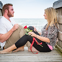 Brandon and Kierstan Engagement. Surprise proposal... windy, at high tide, so the rose was set to capture her eye and then when he got down on his knee...Well,,,.I was there to capture their LOVE