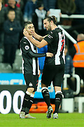 Goal scorer Miguel Almiron (#24) of Newcastle United celebrates with Andy Carroll (#7) of Newcastle United following the Premier League match between Newcastle United and Crystal Palace at St. James's Park, Newcastle, England on 21 December 2019.
