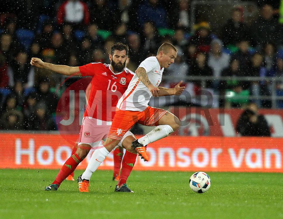 Jordy Clasie of The Netherlands takes on Joe Ledley of Wales - Mandatory byline: Robbie Stephenson/JMP - 07966 386802 - 13/11/2015 - FOOTBALL - Cardiff City Stadium - Cardiff, Wales - Wales v Netherlands - International Friendly