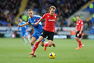 Cardiff city's Magnus Wolff Eikrem holds off Hull city's David Meyler. Barclays Premier league, Cardiff city v Hull city match at the Cardiff city Stadium in Cardiff, South Wales on Saturday 22nd Feb 2014.<br /> pic by Andrew Orchard, Andrew Orchard sports photography.